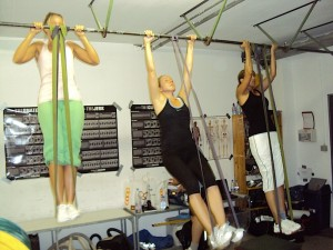 The ladies doing chin ups and pull ups