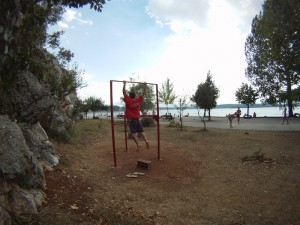 T. doing a kipping pull up in Niksic, Montenegro