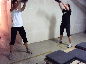 Tiz and Tanja doing a kettlebell swing