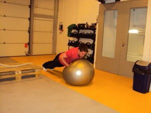 Beni doing a Push up on the Swiss ball