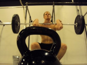 Dommm doing a front squat