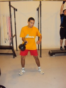 André doing a Kettlebell snatch