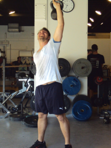 Davide pushes the kettlebell